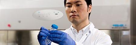 A scientist performing lab duties