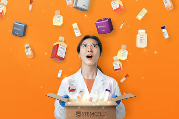 Scientist unboxing STEMCELL products